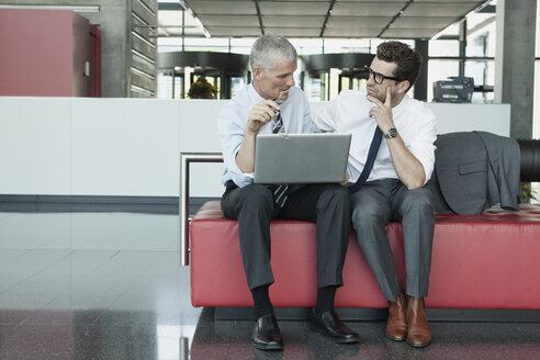 Two businessmen with laptop - CHAF000063
