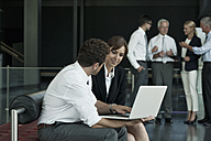 Businessman and businesswoman with laptop - CHAF000069
