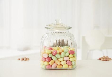 Germany, Munich, Boy with candy jar - FSF000158