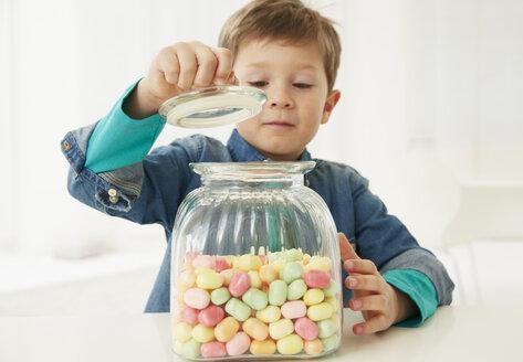 Germany, Munich, Boy with candy jar - FSF000156