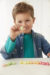 Germany, Munich, Boy with candies - FSF000183