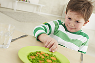 Germany, Munich , Boy doesn't want to eat  peas and carrots - FSF000145