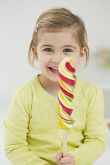 Germany, Girl with lolly pop - FSF000118