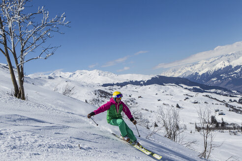 Switzerland, Graubuenden, Obersaxen, female Skier - EG000102