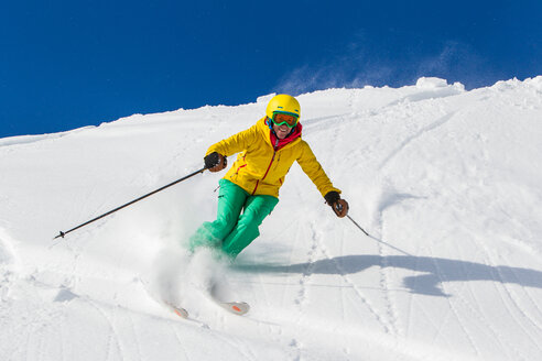 Switzerland, Graubuenden, Obersaxen, female Skier - EGF000036
