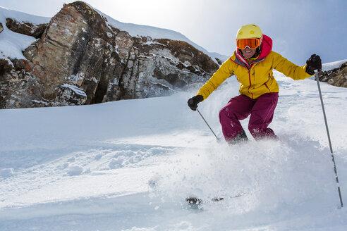 Switzerland, Graubuenden, Obersaxen, female Skier - EGF000041