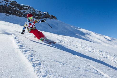 Switzerland, Grisons, Obersaxen, Boy on the slope - EGF000075