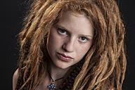 Portrait of teenage girl with red hair dreadlocks - EG000016