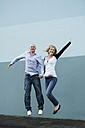 Young couple jumping in the air - PAF000354
