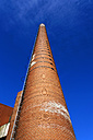 Germany, North Rhine-Westphalia, Minden, view to brickwork smoke stack from below - HOH000447