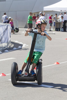Germany, Bavaria, Boy riding segway - EG000096