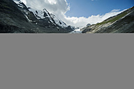 Austria, Grossglockner, Mount Johannisberg, Pasterze Glacier, girl taking a photo - PA000385