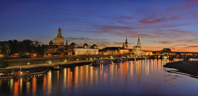Germany, Saxony, Dresden, view to Elbe river and Dresden skyline at sunset - RUEF001206
