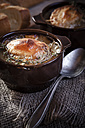 Gratinee onion soup with thyme in bowl - SBDF000570