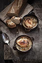 Gratinee onion soup with thyme in bowls and baguette - SBDF000573