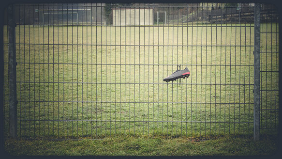 Football boot hangs on fence - SBDF000539