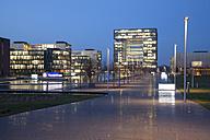 Germany, North Rhine-Westphalia, Essen, Krupp-Guertel, lighted headquarter of ThyssenKrupp at evening twilight - WI000362