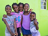 Caribbean, St. Lucia, Soufriere, Smiling girls outdoors - AM001818