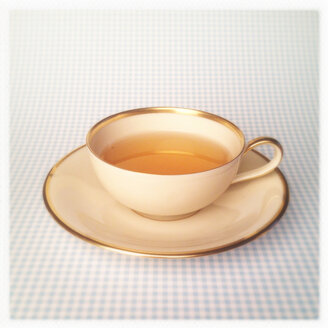 Tea Cup on Light Blue Checkered Background, Golden Rim - MVC000116