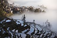 China, Yunnan, Yuanyang, Overcast rice terraces and village - JBAF000090