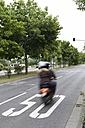 Germany, Hesse, Moped speeding in street - AMF001857