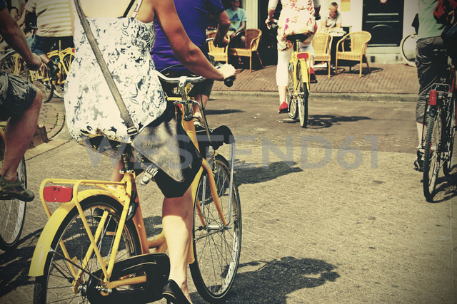 Netherlands, Amsterdam, People on hire bikes - HOH000481