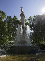 Germany, Berlin, fountain and sculpture of golden deer at park in Berlin-Schoeneberg - LAF000551