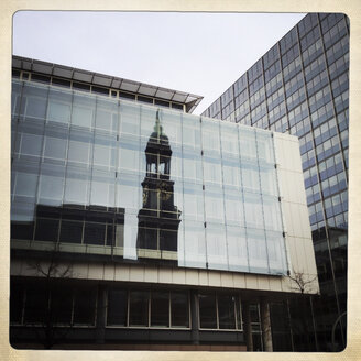 Reflection of St. Michael's Church (Michel) in a modern glass facade, Hamburg, Germany - ZMF000223
