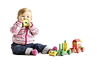 Toddler playing with wooden toy in front of white background - IPF000013