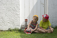 Brother and sister playing fire brigade - CRF002576