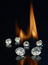 Diamonds in front of a flame - AKF000282