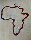 Diamonds lying on a map of Africa drawn with blood - AKF000277