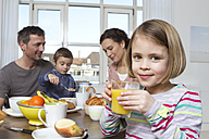 Family of four having healthy breakfast - RBYF000446