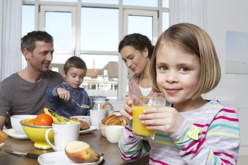 Family of four having healthy breakfast - RBYF000446