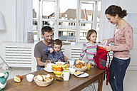 Family of four having healthy breakfast - RBYF000449