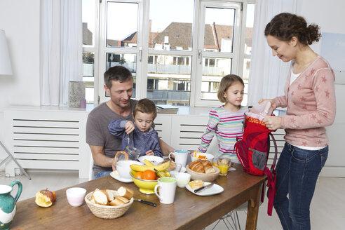 Family of four having healthy breakfast - RBYF000449