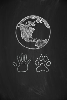 Human hand and animal paw united  under drawing of the Earth - MW000012