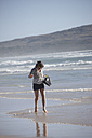 South Africa, Mature woman running at Nordhoek Beach - AKF000285