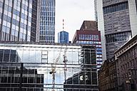 Germany, Hesse, Frankfurt, skyscrapers, glass front, reflection of construction crane - ZMF000254
