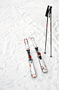 Germany, Eschach, Skis and ski poles in snow - JED000165