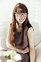 Portrait of smiling young woman wearing glasses - MFF000898