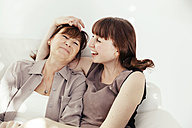 Portrait of mother and daughter laughing together - MFF000902