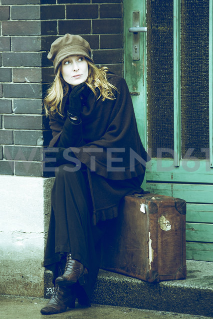 Woman sitting on her suitcase waiting - NG000077 - Nadine Ginzel/Westend61