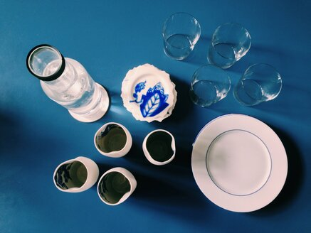 Blue table set with different cups, glasses and plates - MEAF000140