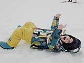 Happy boy lifting his hands in snow outfit - MEAF000182