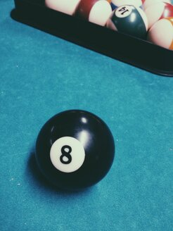 Billiard ball with black number 8 on pool table - MEAF000194