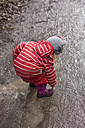 Toddler playing with a puddle of mud - IPF000030
