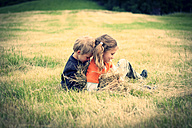 Boy and girl rampaging on a meadow - PA000426