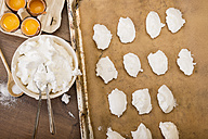 Bowl of beaten egg white for meringues and formed raw meringues on baking tray - CSTF000030