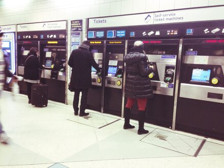 People getting Underground tube tickets at station in London, UK - MEA000122
